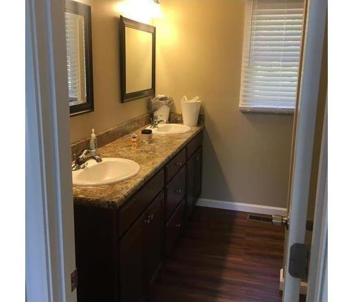 Lit bathroom with twin sinks
