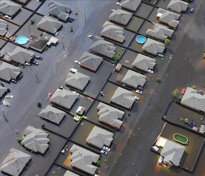 Rows of homes partially submerged by flood waters