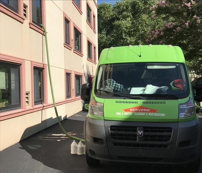 SERVPRO vehicle outside of apartment building